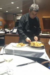 Jose serves paella